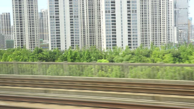 high-speed train leaves hangzhou east railway station, hangzhou city construction scenery - abstract stock videos & royalty-free footage