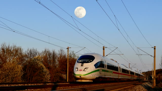 high-speed train under the supermoon - passenger train stock videos & royalty-free footage