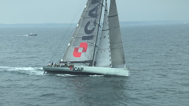 High-tech racing sailboats cross the Atlantic Ocean in race to the UK.