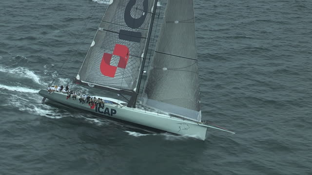 High-tech sailboats travel through the Atlantic Ocean in a race to the UK.