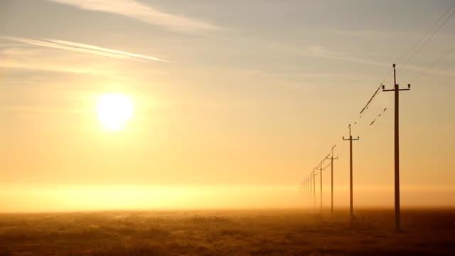 High-voltage power line at dawn