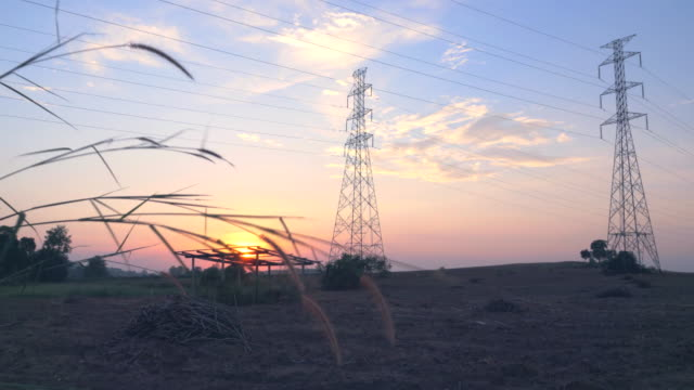 4k: high-voltage power lines at sunset - transformer stock videos & royalty-free footage