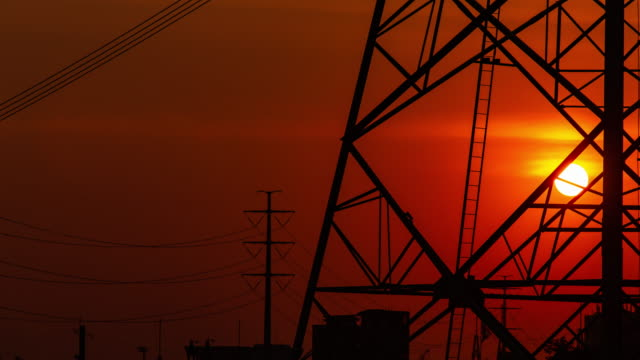 high-voltage power lines at sunset. - high voltage sign stock videos & royalty-free footage