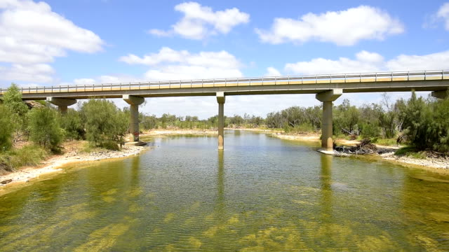 highway 1 - galena bridge over the murchison river. western australia - camper trailer stock videos and b-roll footage