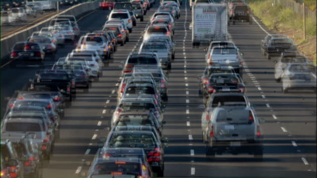 US Highway 101 in Marin County California at evening rush hour at Seminary Highway exit.  Photograph shows the rush hour traffic heading both north and south along a major interstate artery just north of San Francisco,