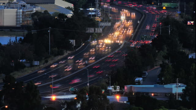US Highway 101 in Marin County California at evening rush hour.  Photograph shows the rush hour traffic heading both north and south along a major interstate artery just north of San Francisco, California.