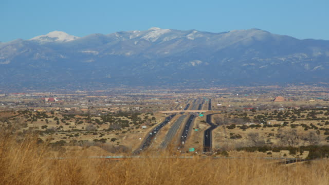 T/L highway 25 north to Santa Fe New Mexico vast space mountain background.