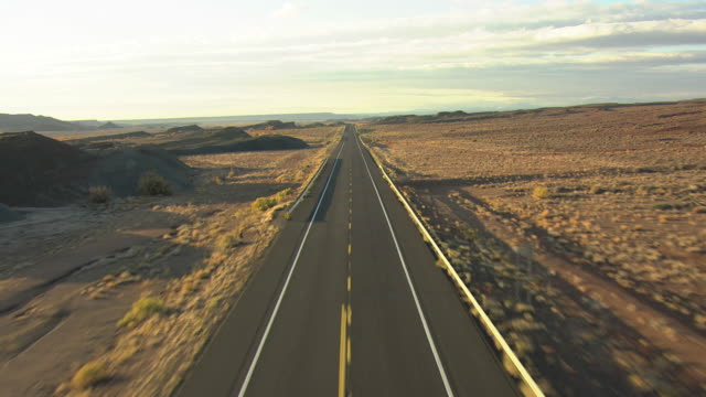 ws aerial zi zo highway 89 through painted desert in coconino county / arizona, united states - empty road stock videos and b-roll footage