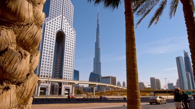 highway along dusit thani hotel and burj khalifa - burj khalifa stock videos & royalty-free footage