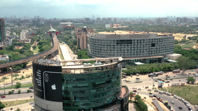 highway and an office building in new delhi, india - new delhi stock videos & royalty-free footage