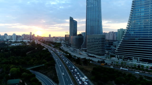 highway and skycrapers at sunrise (istanbul) 4k - istanbul stock videos & royalty-free footage