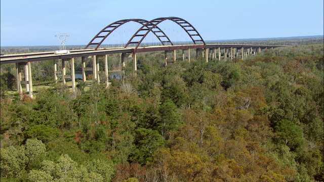 a highway bridge crosses a river in louisiana. - interstate 10 stock videos & royalty-free footage