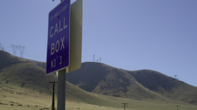 cu tu highway call box sign with highway and hills in background, palmdale, california, usa - palmdale stock videos and b-roll footage