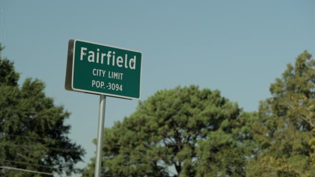 "Highway city limits sign, ""Fairfield city limit pop 3094."""