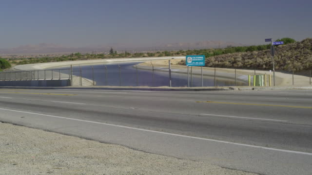 ms highway crossing canal in desert landscape, palmdale, california, usa - palmdale stock videos and b-roll footage