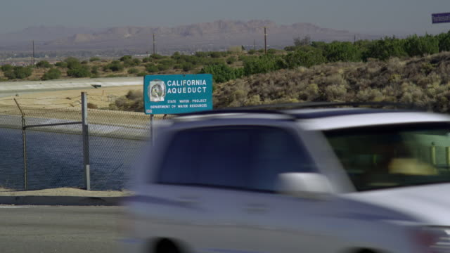 ms highway crossing canal with hills in background, palmdale, california, usa - palmdale stock videos and b-roll footage