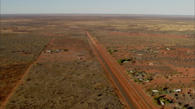 AERIAL Highway crossing desert landscape, Darwin, Northern Territory, Australia