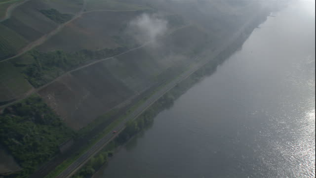 a highway divides farms from the rhine river. - river rhine stock videos & royalty-free footage