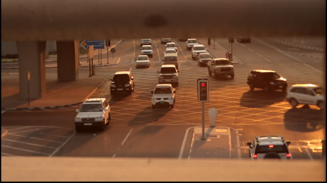 highway, doha, qatar. view from a bridge of the flow of traffic on a busy highway in doha at sunset. - on the move stock videos & royalty-free footage