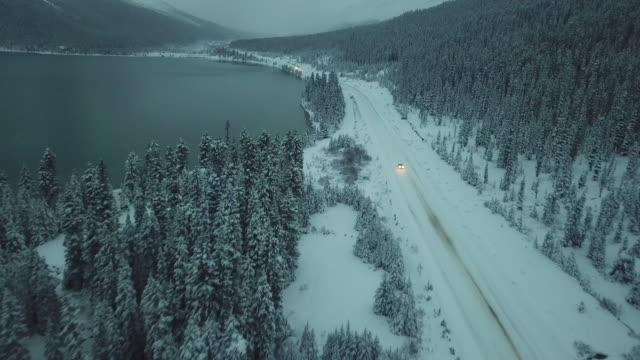 highway driving along snow field - canada stock videos & royalty-free footage