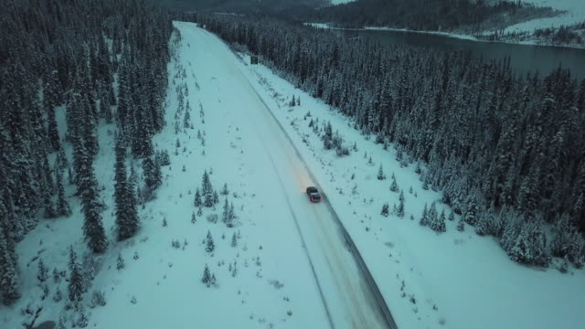 highway driving along snow field - winter stock videos & royalty-free footage