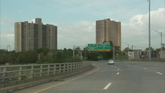 Highway freeway expressway Ben Franklin BridgePhiladelphia Rutgers University street exit signs highrise buildings