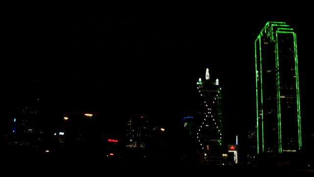 Highway freeway overpass Bank of America Plaza skyscraper w/ iconic green lighting highrise buildings ZI/ZO