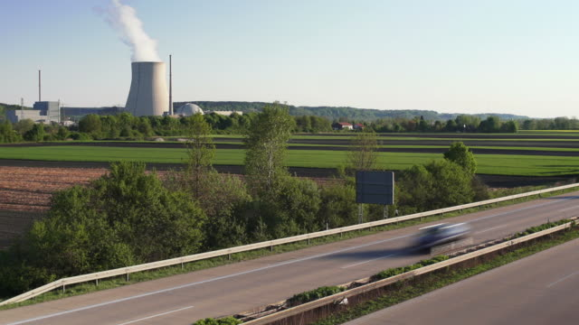 highway in front of nuclear power station (4:2:2@100 mb/s) - nuclear reactor stock videos and b-roll footage