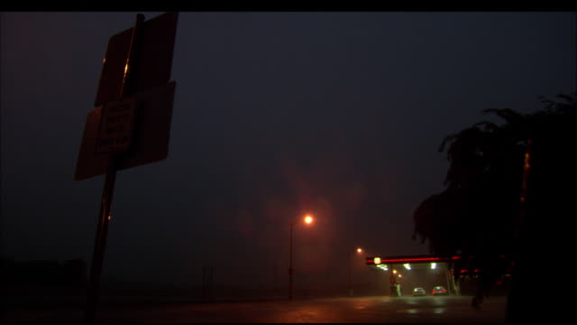 vídeos de stock e filmes b-roll de ms, highway in heavy wind and rain with flashes of lightning at night, oklahoma, usa - 2007
