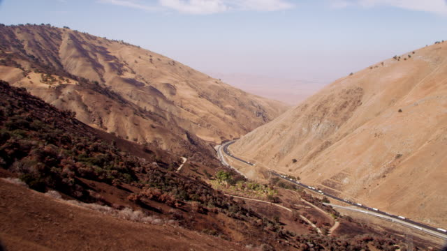 highway in mountains - arid stock videos and b-roll footage