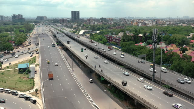 highway in new delhi, india - modern stock videos & royalty-free footage