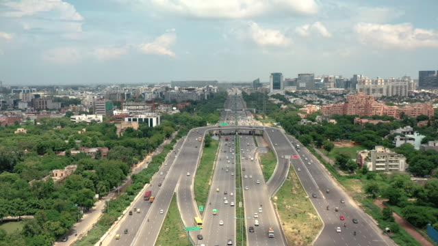 highway in new delhi, india - colour image stock videos & royalty-free footage