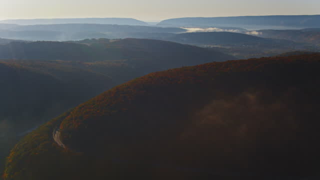 highway in the appalachian mountains in the early morning in the fall season. drone-made video with the ascending camera motion. - mountain ridge stock videos & royalty-free footage