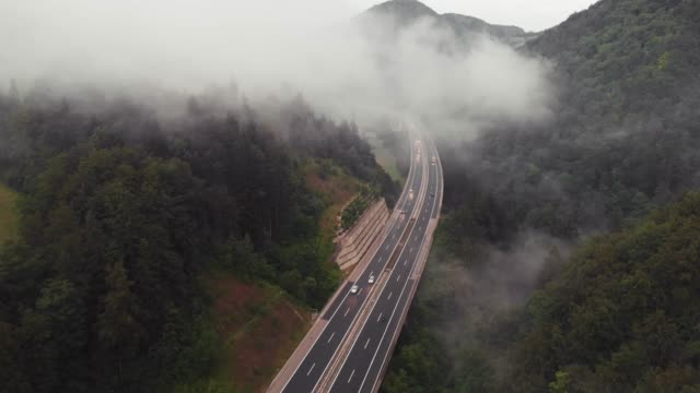 highway in the morning; aerial view - truck stock videos & royalty-free footage