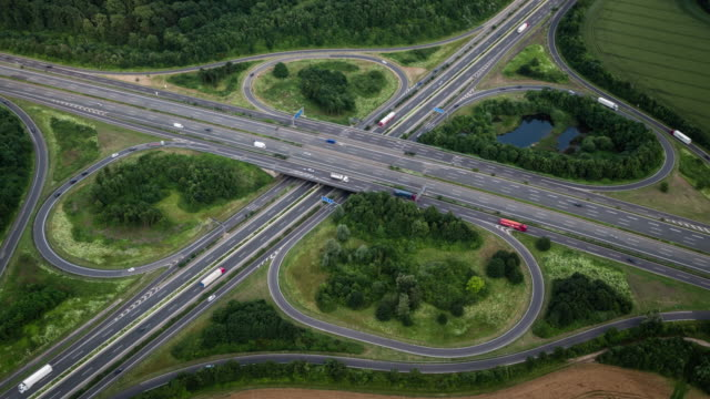 highway interchange, aerial view - clover leaf shape stock videos and b-roll footage