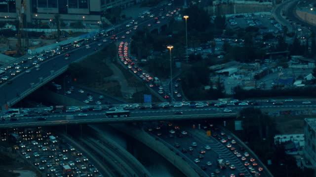 highway interchange at dawn with very busy rush hour traffic in urban tel aviv - tel aviv stock-videos und b-roll-filmmaterial