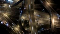 Highway interchange with traffic. Aerial shot. UHD, 4K