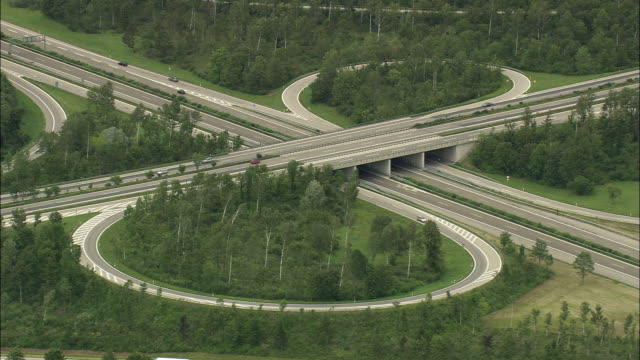 aerial highway intersection, munich, bavaria, germany - mehrspurige strecke stock-videos und b-roll-filmmaterial