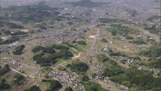 a highway is next to the kitora tumulus in nara. - 大昔の点の映像素材/bロール