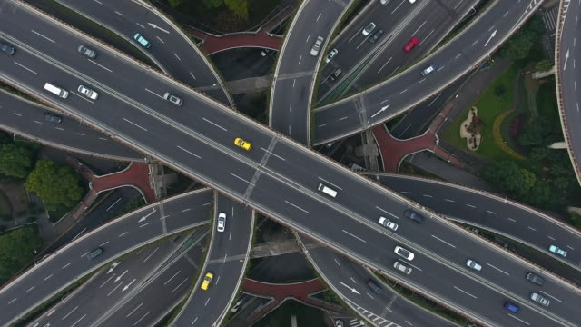highway junction aerial view - car on road stock videos & royalty-free footage