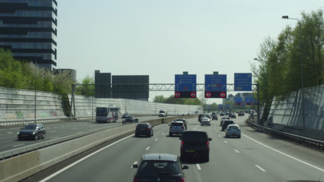 pov highway near amsterdam - commercial land vehicle stock videos & royalty-free footage
