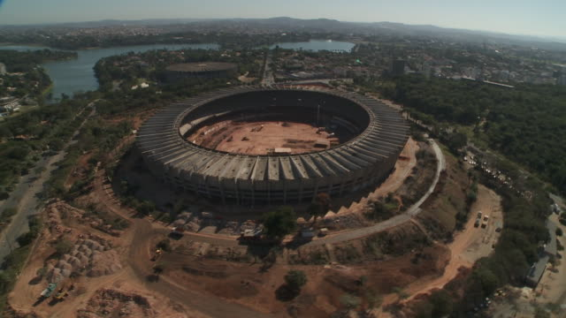 a highway passes the giant construction site of a sports stadium in belo horizonte, brazil. - belo horizonte stock videos and b-roll footage