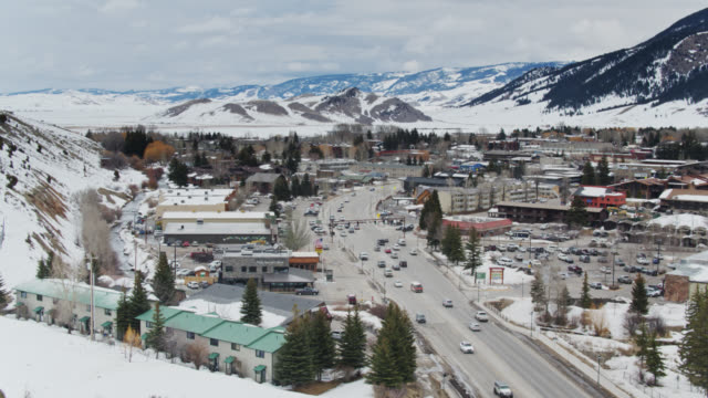 highway running through jackson, wyoming - antenne - jackson hole stock-videos und b-roll-filmmaterial