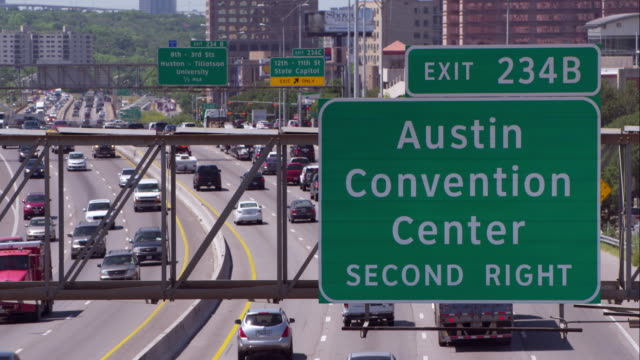 stockvideo's en b-roll-footage met highway sign for the austin convention center over interstate 35 - austin texas