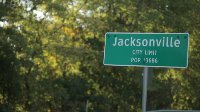 "Highway sign - ""Jacksonville City Limit pop. 13686."""