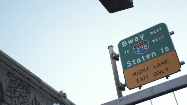 a highway sign leading to staten island, new york city - staten island stock videos and b-roll footage
