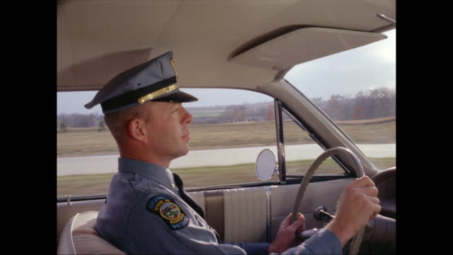 MS POV Highway State Patrolman driving car on road / United States