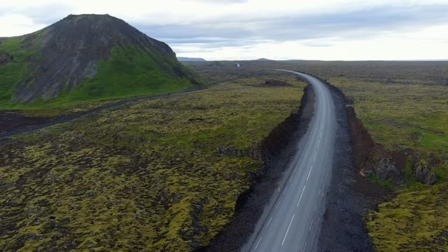 highway through iceland landscape - empty road stock videos and b-roll footage