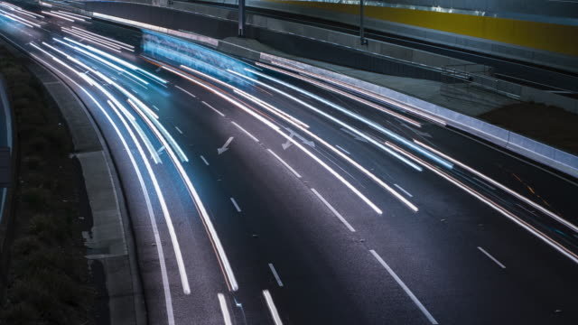 highway timelapse at night - headlight stock videos & royalty-free footage