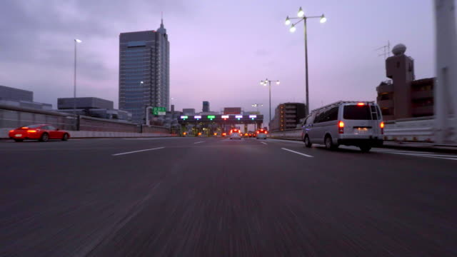 highway toll gate passing at morning - 4k- - length stock videos & royalty-free footage